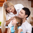 Family with the child on kitchen — Stock Photo