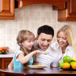 Stock Photo: Breakfast of happy family