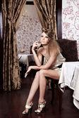 The beautiful girl at restaurant — Stock Photo