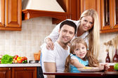 Parents with the child on kitchen — Stock Photo