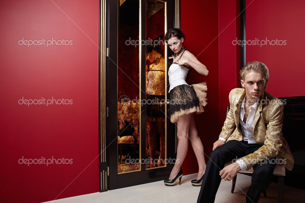 Young man and the girl in an interior  Stock Photo #4512059