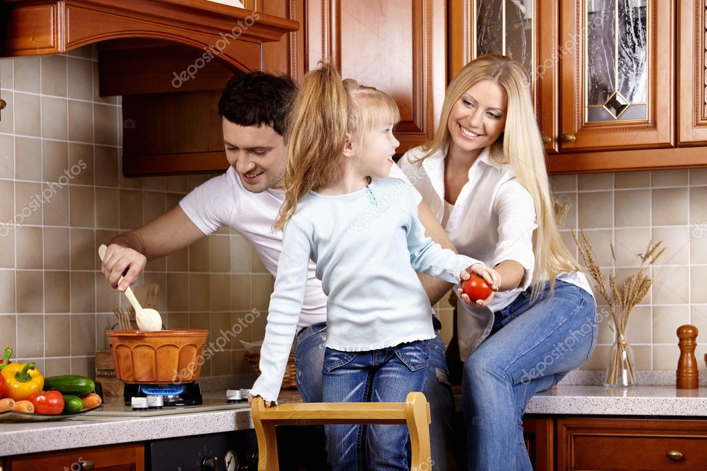 The family on kitchen makes a dinner — Stock Photo #4512205