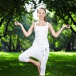 A girl in one of the yoga postures — Stockfoto