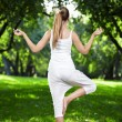 Girl do yoga back — Stock Photo