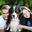 Portrait of couple with dog — Stock Photo