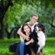 The happy couple with a dog — Stock Photo