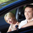 The happy couple in the car - Stock Photo