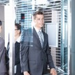 Business man in the elevator — Stock Photo