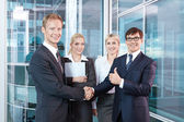 Businessmen shake hands after concluding a successful transaction — Stock Photo
