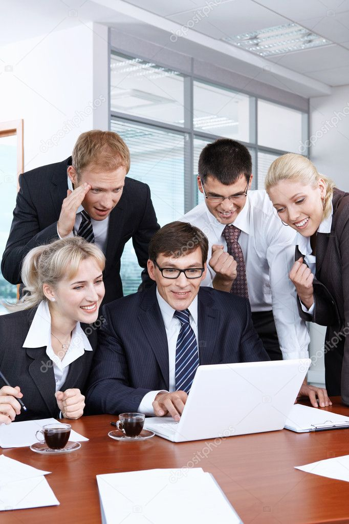 Young businesspeople in an office happy success — Stock Photo #4593892