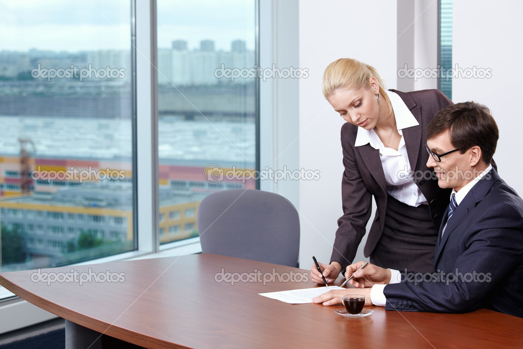 She signed the papers of his boss — Stock Photo #4594028