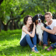 Foto de Stock  : Couple with dog