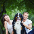 A couple with a dog in park — Stock Photo