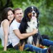 Young couple with a dog — Stock Photo #4604616