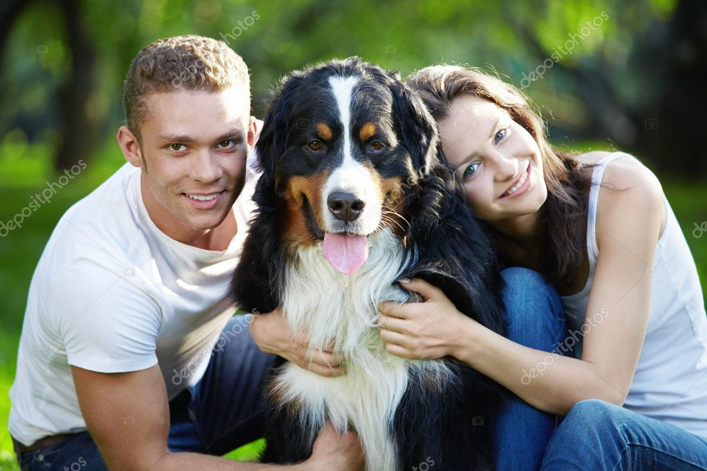 Portrait of a young couple with a dog — Stock Photo #4604623