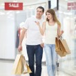 Attractive couple in shop - Foto Stock