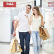 Attractive couple in shop — Stock Photo