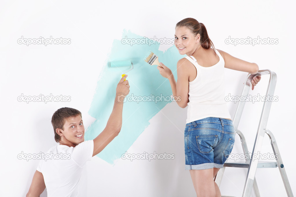Young attractive couple paints the wall  Stock Photo #4689171