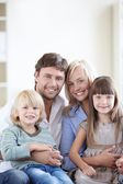 Young family with two children — Stock Photo