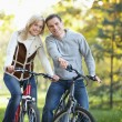 Attractive couple on bikes — Stock Photo