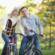 Attractive couple on bikes - Stock Photo