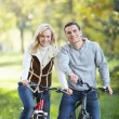 Stock Photo: Young couple on bikes