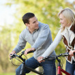 Attractive couple on bicycles — Stock Photo #4716632