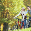 Attractive couple on bicycles — Foto de Stock