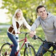 Couple on bicycles — Stock Photo