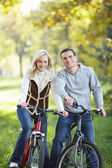 Young couple on bikes — Stock Photo