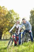 Couple on bicycles — Stock Photo