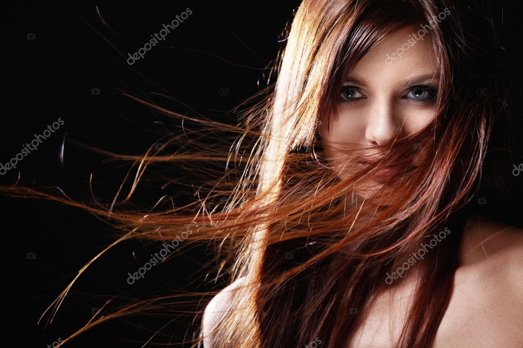 Beautiful girl with flowing hair on a black background — Stock Photo #4715960