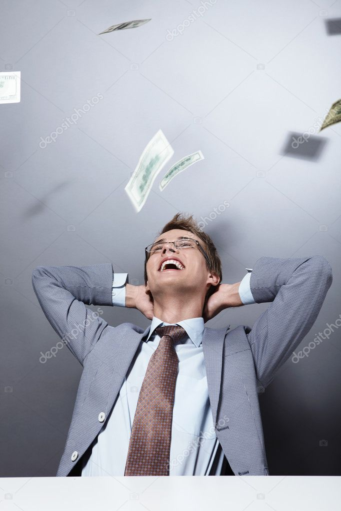 Laughing businessman on a background of flying money — Stock Photo #4716411