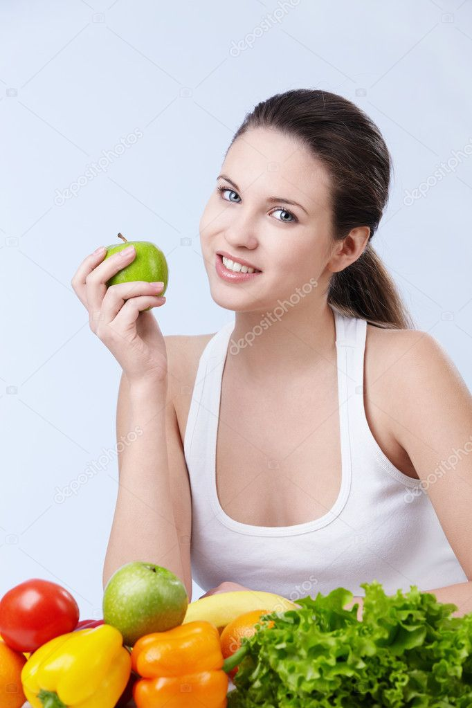 Young attractive girl with fruits and vegetables on white background — Stock Photo #4849961
