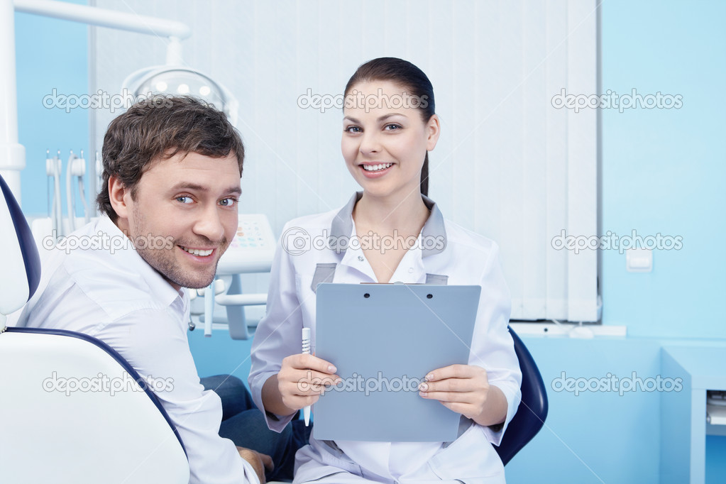 Doctor and patient in the dental clinic — Stock Photo #4850472