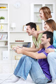 Young friends playing games — Stock Photo