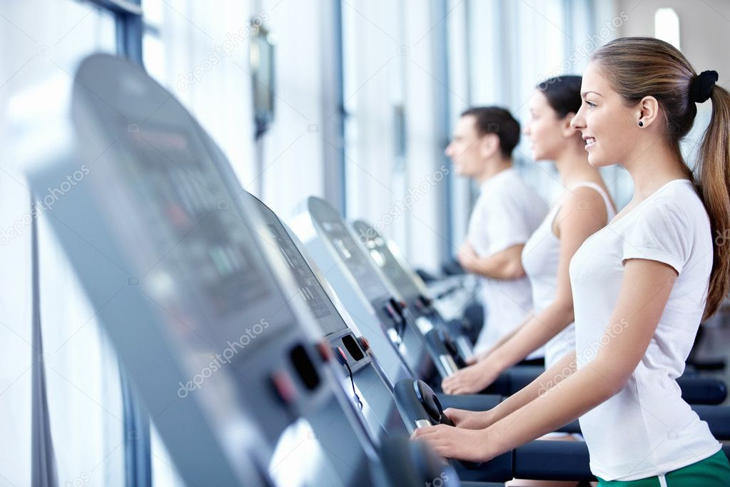Young attractive girl on the treadmill — Stock Photo #5040157