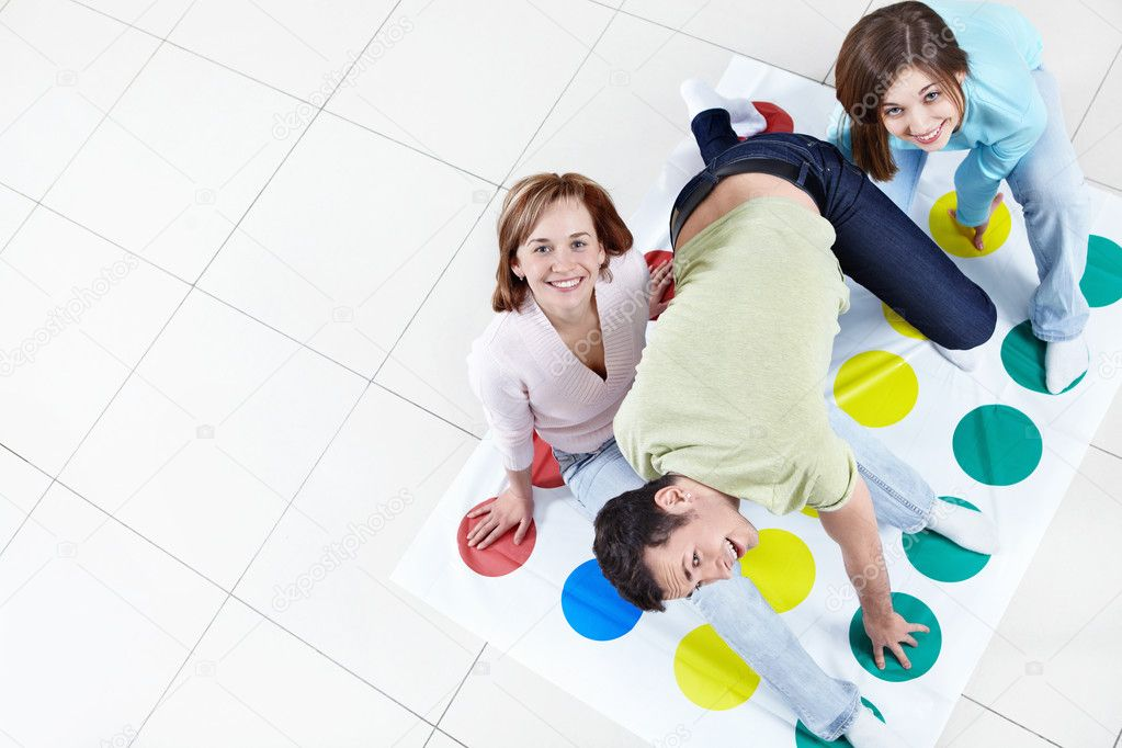Young happy playing twister — Stock Photo #5051119