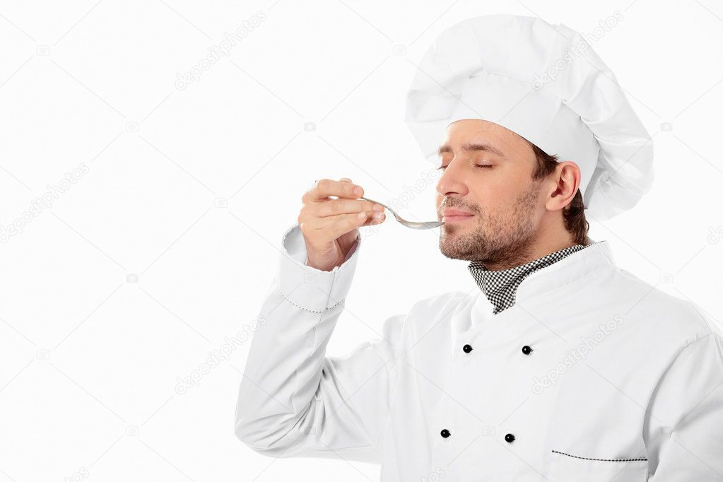 Young chef brings the spoon to her mouth on a white background — Stock Photo #5336763