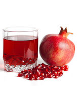 Glass filled by juice of a pomegranate and the seeds of a pomegr — Stock Photo