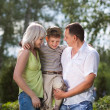 Family having a walk outdoors — Stock Photo
