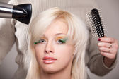 Young woman gets a hairdo — Stock Photo
