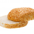 Cutting bun with sesame seeds — Stock Photo