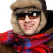 Man in fur hat with sunglasses macro — Stock Photo