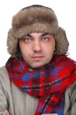 Man in a fur hat close up — Stock Photo