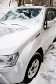 Automobile under snow close up — Stock Photo