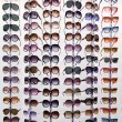 Rack with sunglasses — Stock Photo