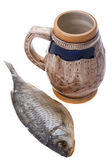 Dry fish with cup of beer — Stock Photo