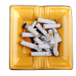 Stock Photo: Ashtray with cigarette butts macro