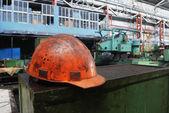 Dirty orange helmet — Stock Photo